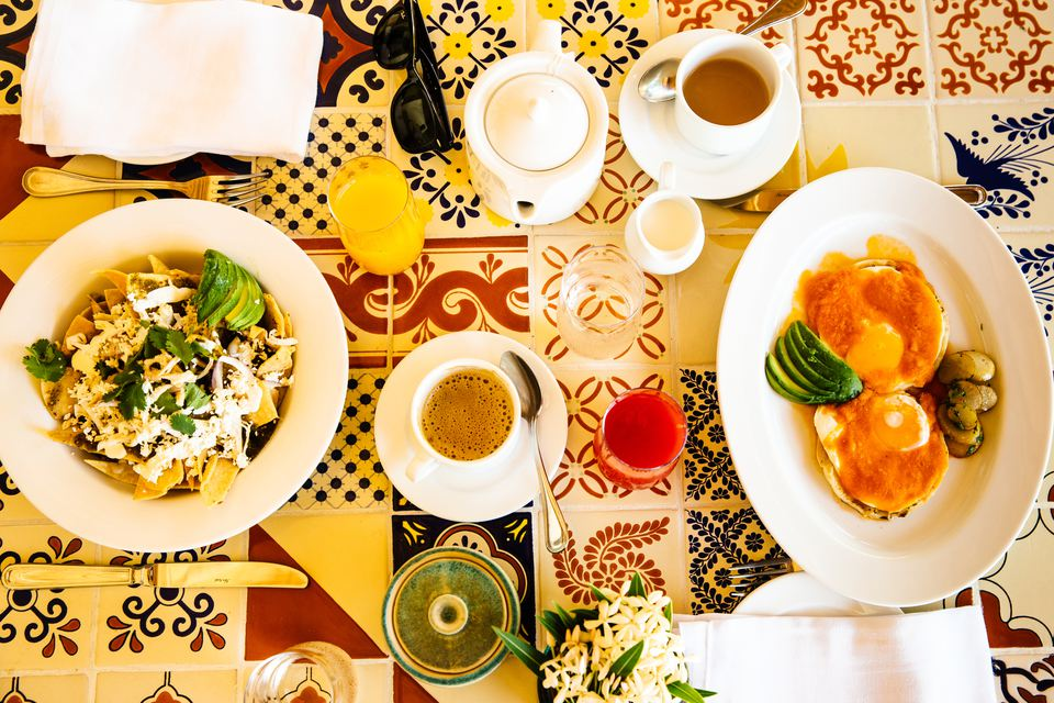 Overhead view of colorful hotel breakfast table, Tulum, Riviera Maya, Mexico
