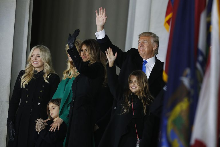Donald Trump with his wife Melania and members of his family on the steps of the Lincoln Memorial. How did Trump become so popular and achieve the presidency?