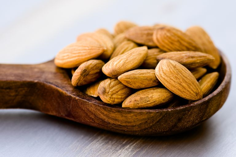 Almonds on a wooden spoon