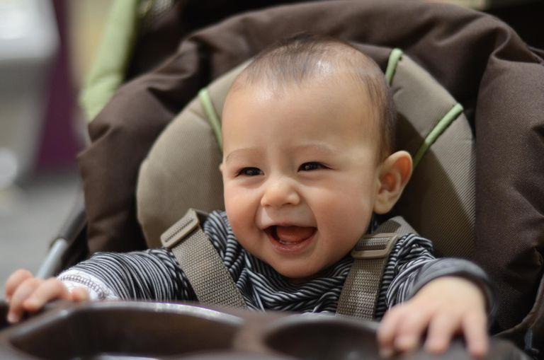Happy baby boy in stroller
