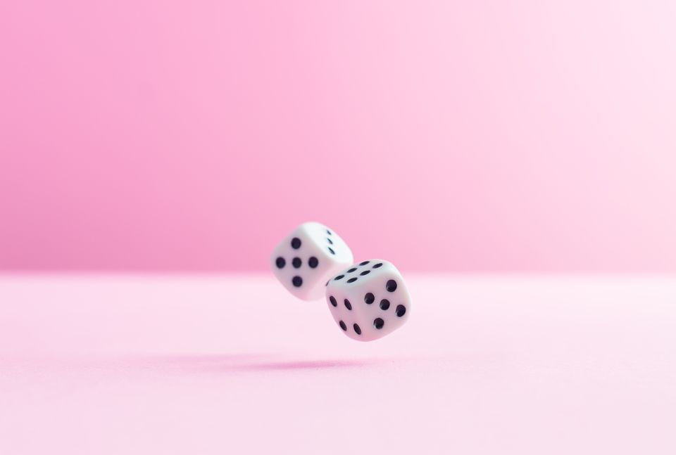 Studio Shot Of Two Dice Over Pink Background