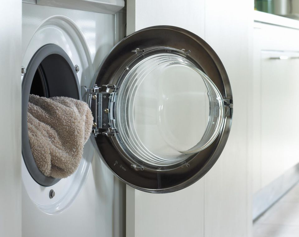 Close-up of a Towel in a Washing Machine, With the Washing Machine Door Open