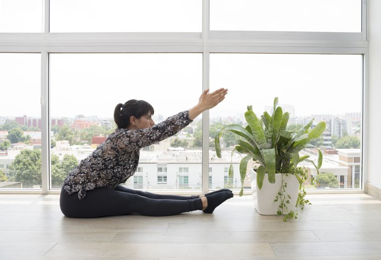 woman doing Pilates exercise in living room