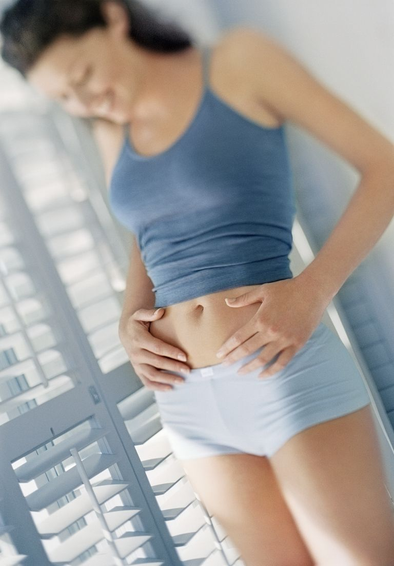 Woman Looking at her Stomach