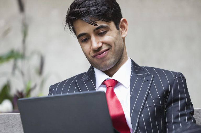 An Indian businessman using PC