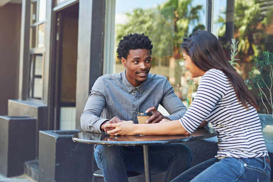 Couple having conversation at outdoor cafe