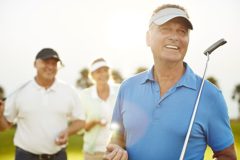 mature people playing golf