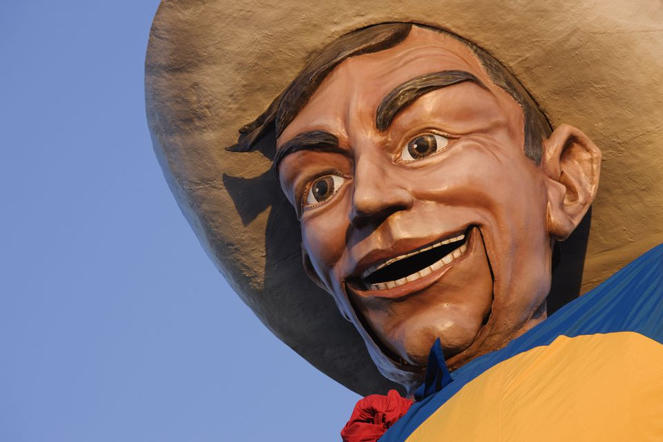 Close up of cowboy mascot under blue sky