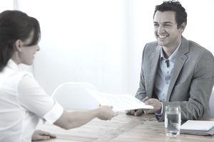 interviewer receiving documents
