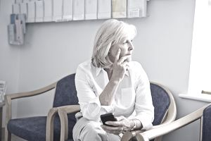 Mature female patient with mobile phone