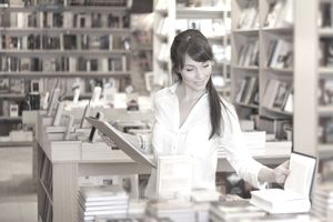 Female book store employee doing inventory