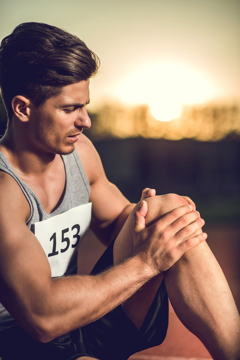 Male athlete injured his knee on a sports training.