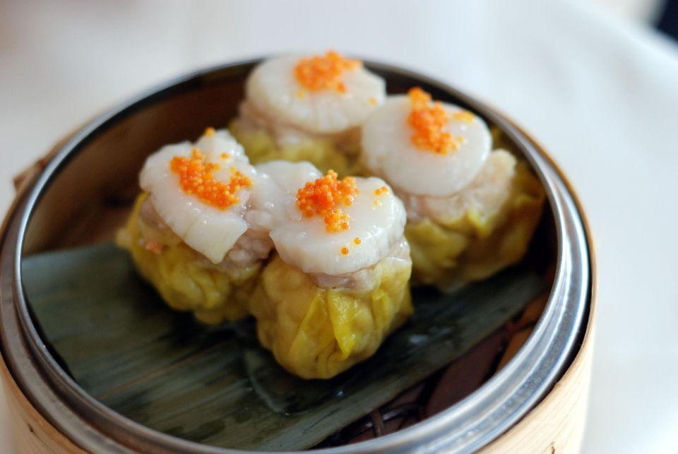 Siu Mai of pork, shrimp and scallop in steam box.