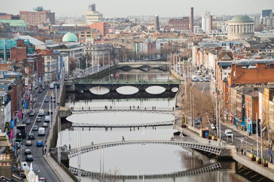 View of Dublin City from high point with Ha'Penny bridge, Millenium Bridge, Grattan bridge, Four Courts, Guinness brewery and other buildings.