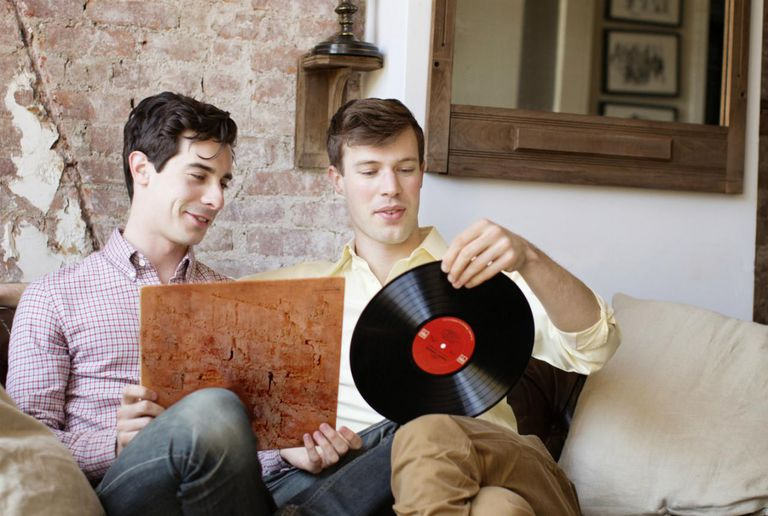 Two Men Looking at Music Records