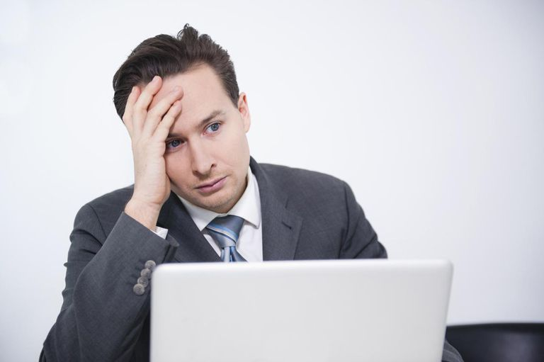 Businessman stressed out in office