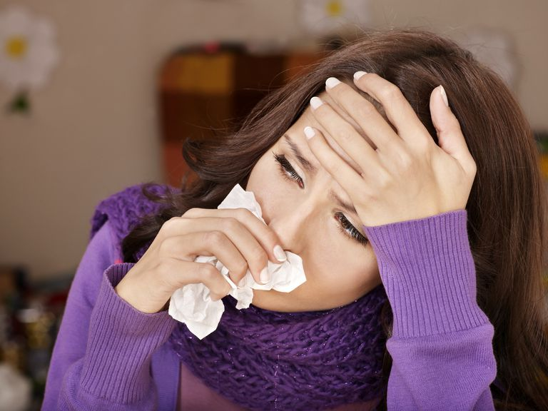 woman with sinus drainage and migraine headache