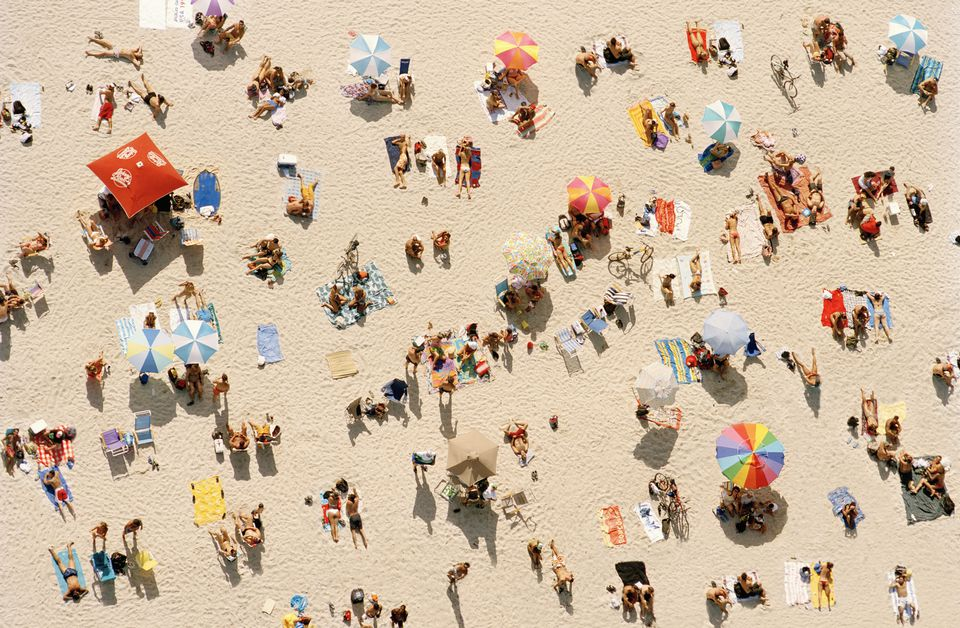 People relaxing at beach, aerial view