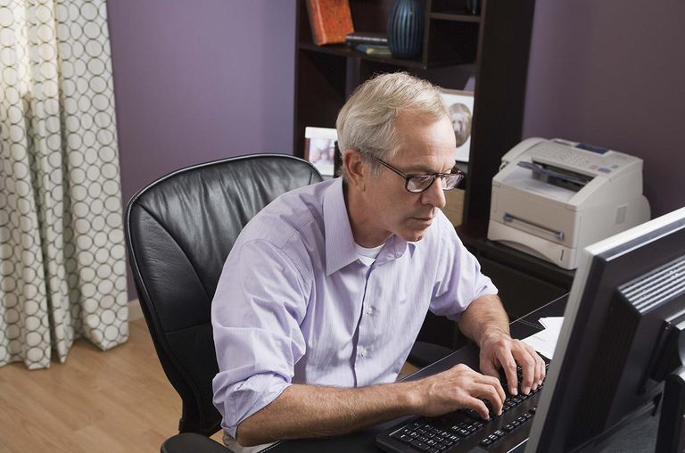 Picture of a man typing on his computer