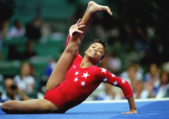 Gymnast Dominique Dawes competes at the 1996 Olympics on floor.