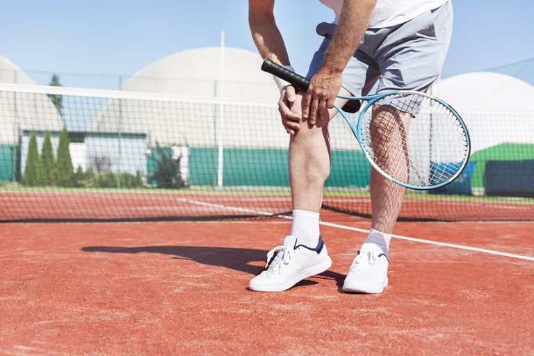 Tennis player with knee injury