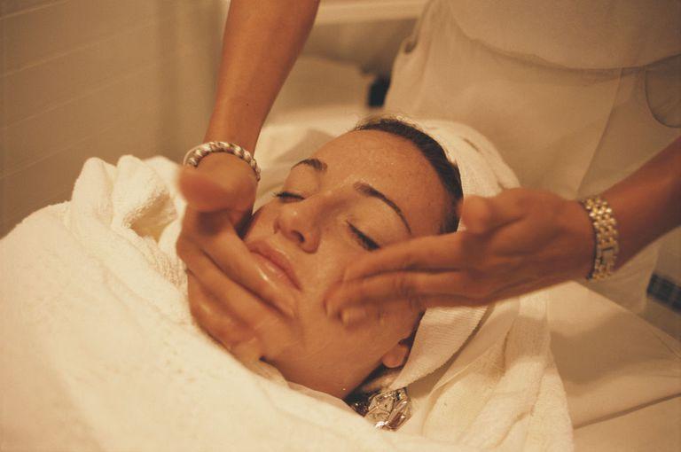 A woman receiving a facial spa treatment, Bonaire, Netherlands, March 2000.