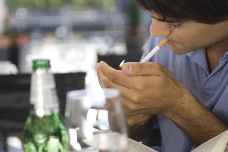 Man Lighting Cigarette in Bar