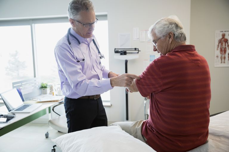 Senior man being examined by his doctor