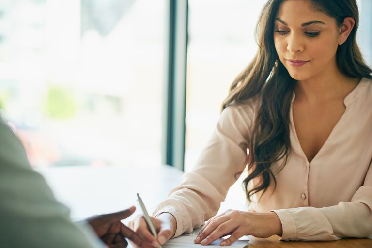 Woman reviewing HSA and FSA Options in Office at Work