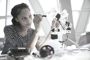 Engineer working on robotic arm