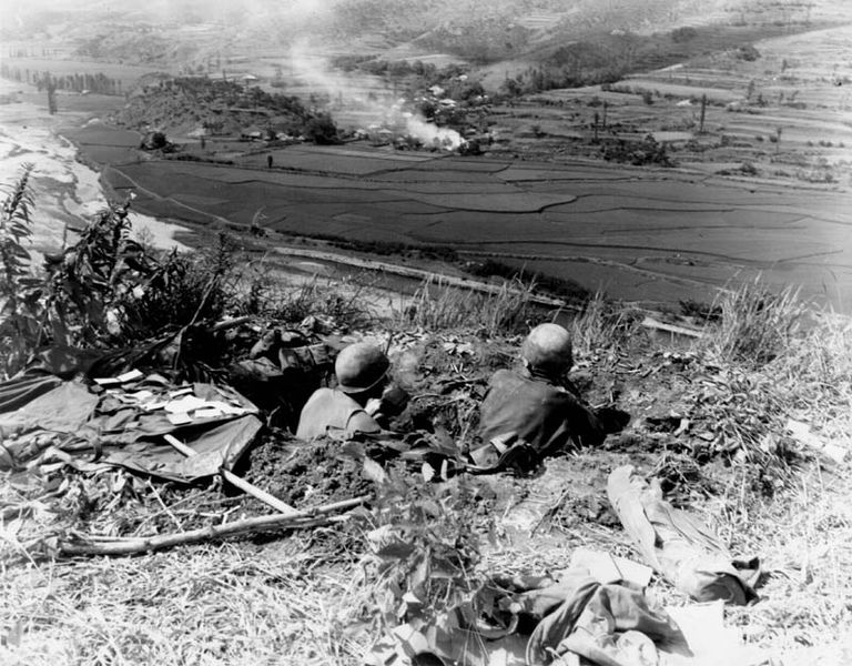 American armed forces firing at North Koreans in the Korean War