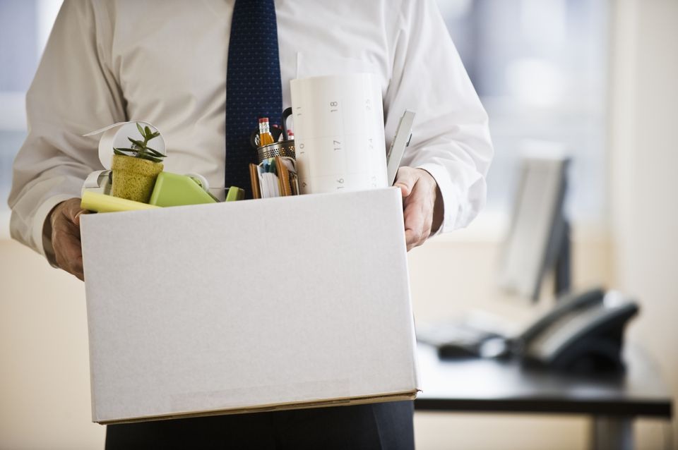 Man taking belongings out of workplace.