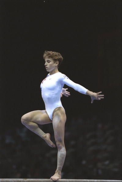 Gymnast Kerri Strug does a pose on beam at the 1996 Olympics