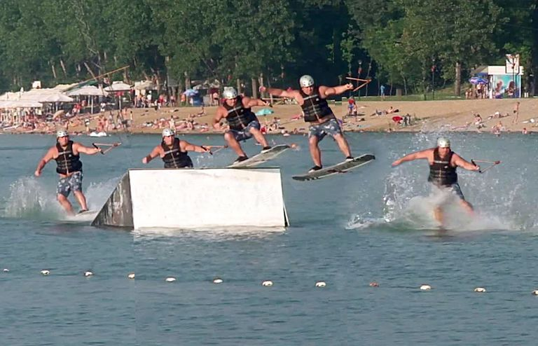wakeboarder jumping off a ramp