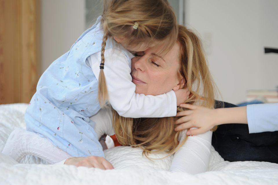 Girl kissing her mother