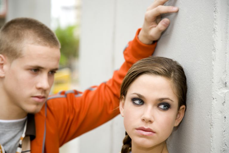 teen girl looking away from boyfriend