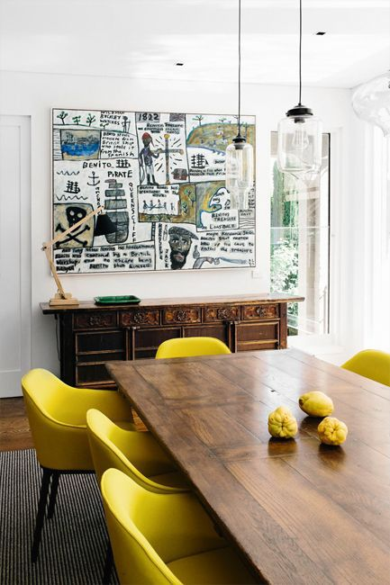 Dining Room With Bright Yellow Chairs