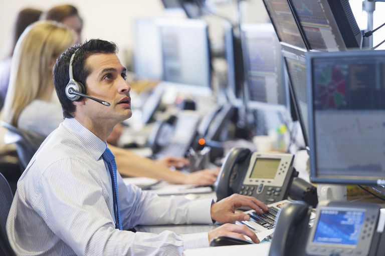 Securities traders enjoy fast-paced, high paying careers.