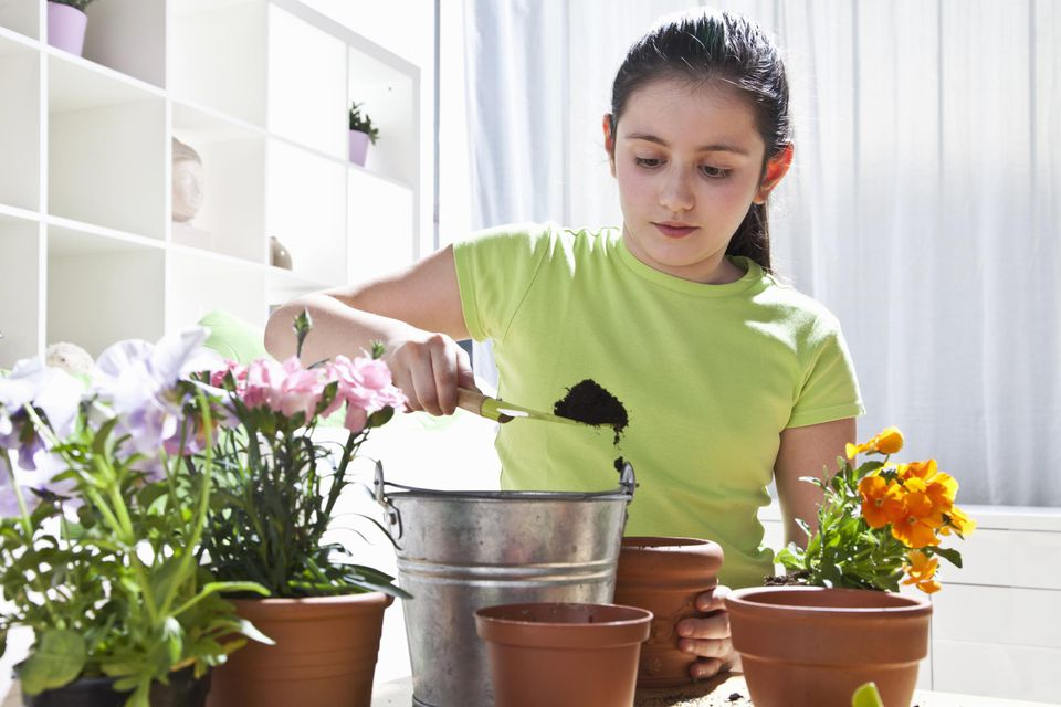 Little girl playing gardening