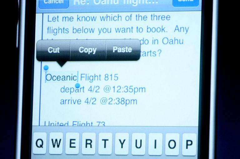Press and hold text on the iPhone to open the Copy and Paste menu.