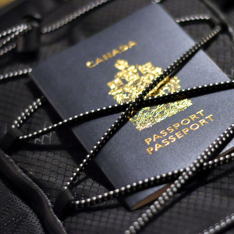 A Canadian passport strapped to luggage.