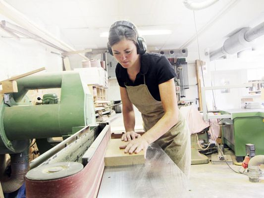 Female carpenter working in workshop