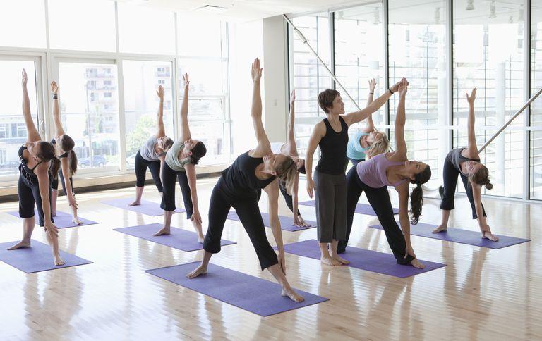 Yoga Teacher Leading a Class