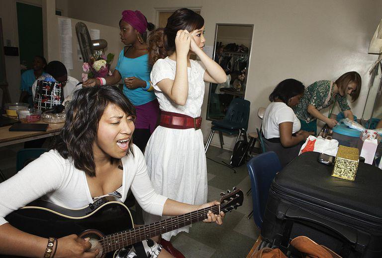 Teenage girls getting ready backstage