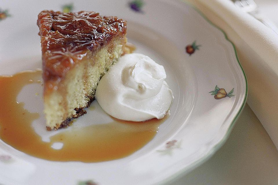 Slice of upside down cake with whipped cream