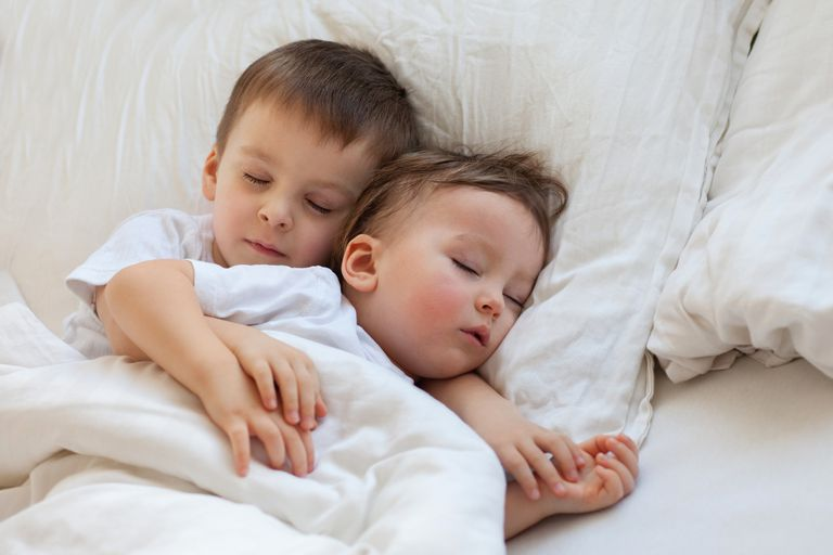 Two boys sleeping, brothers