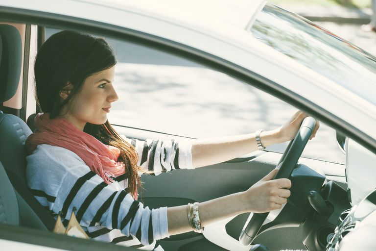 Spain, Barcelona, Young woman in car