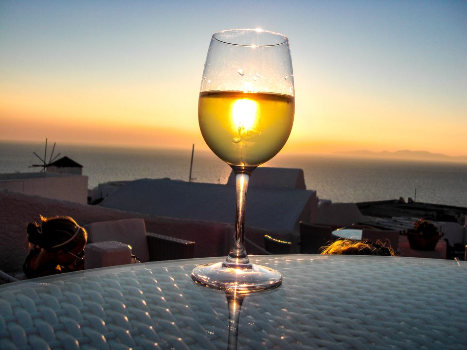 Champagne Served On Table In Restaurant By Sea At Santorini
