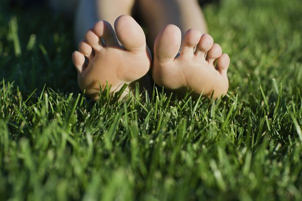 bare feet in grass