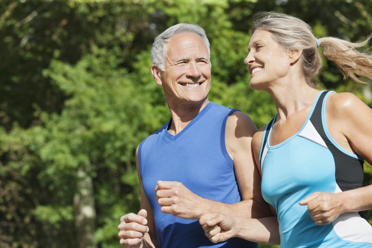Close up of mature couple running together